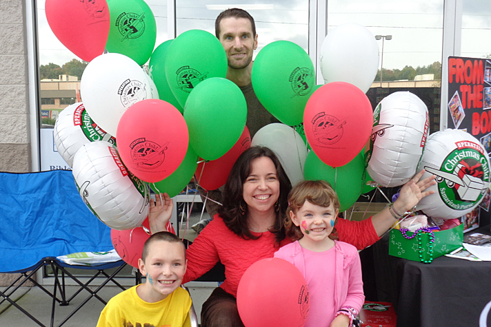 Family with OCC balloons