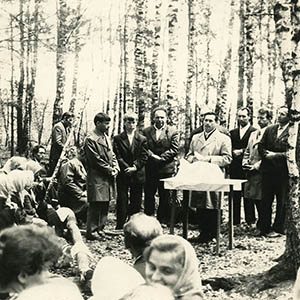 Joseph Bondarenko and other members of an underground church celebrate the Lord's Supper in a forest.