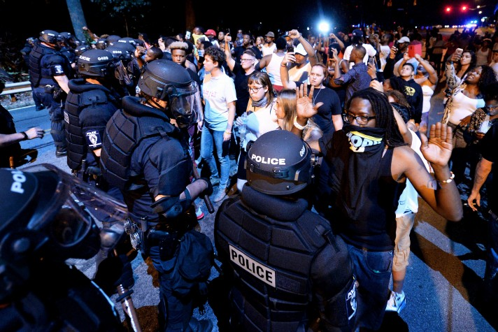 As the night wore on and the violence intensified, police put on their riot gear similar to what they wore during Tuesday's violent unrest.