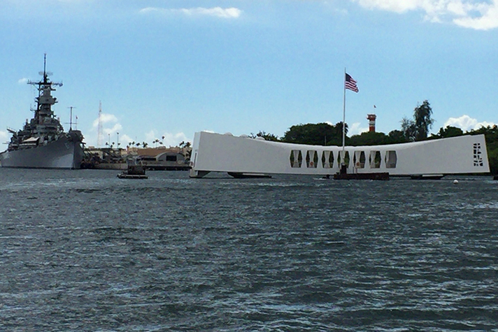 Current day: 75 years after the attack at Pearl Harbor, a memorial to those who perished aboard the USS Arizona (right) draws more than 2 million annual visitors. The vessel to the left is the USS Missouri. EPA/KIMIMASA MAYAMA (Newscom)