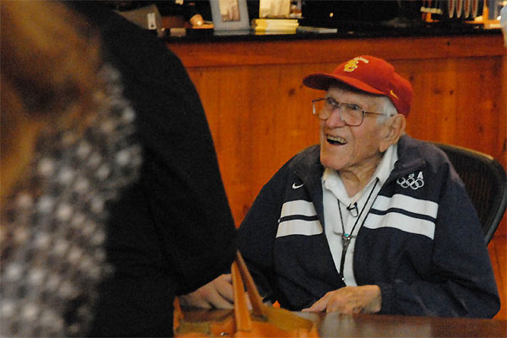Louis Zamperini greets guests at a June 2011 book-signing at the Billy Graham Library.
