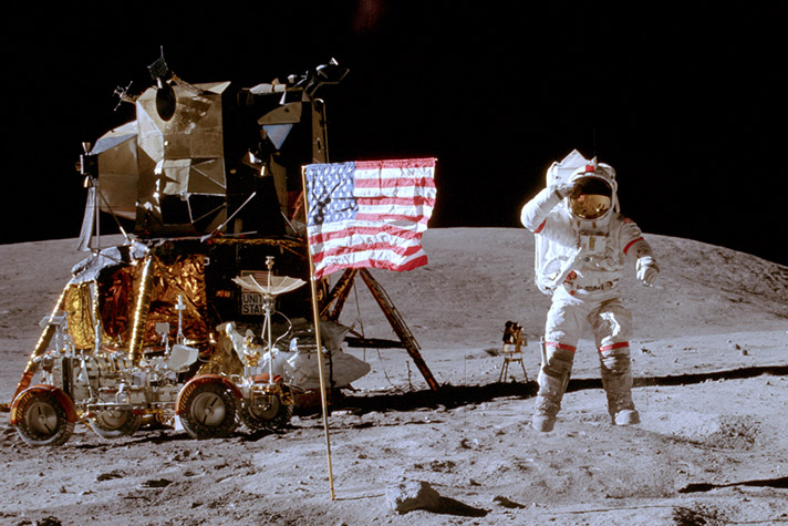 "Charlie Duke salutes the American flag on April 16, 1972 as he stands on the lunar surface. ""Walking on the moon was three days,"" he said. ""But walking with Jesus is forever."" (photo credit: NASA)"