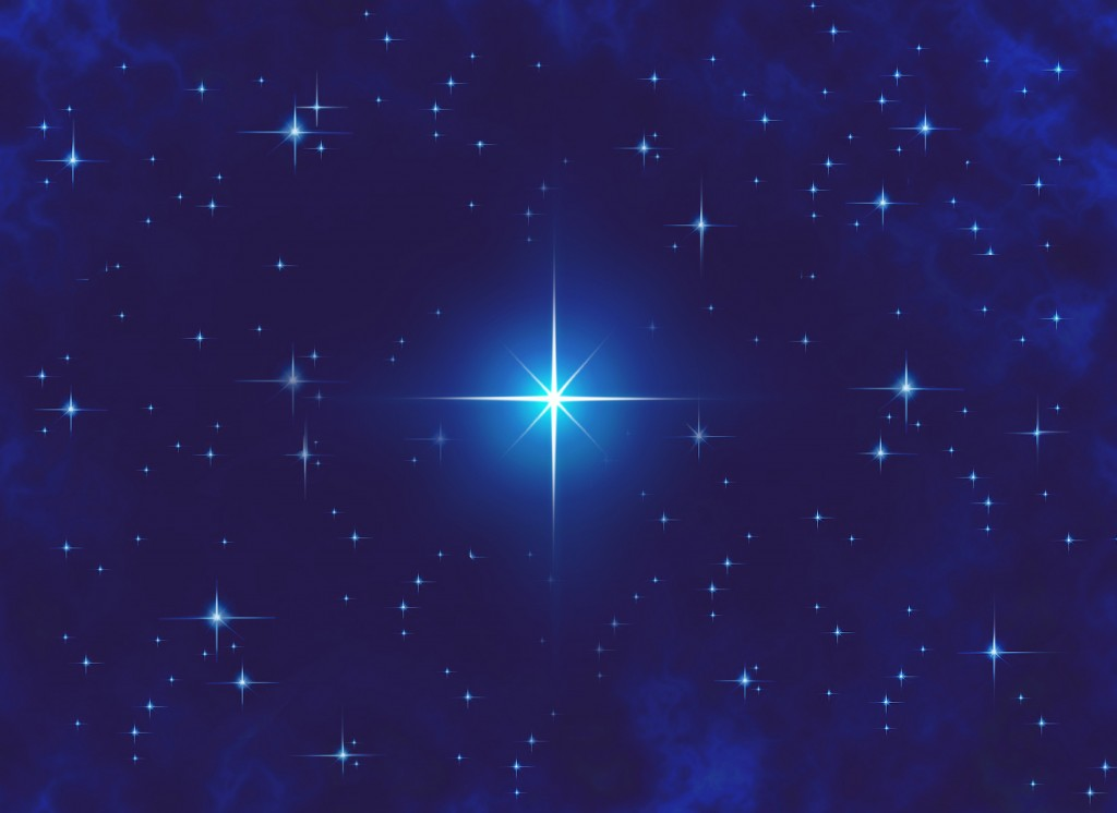 Star sparkling in night sky