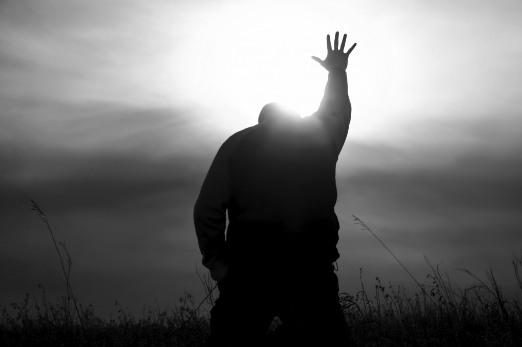 Man kneeling with arm outstretched