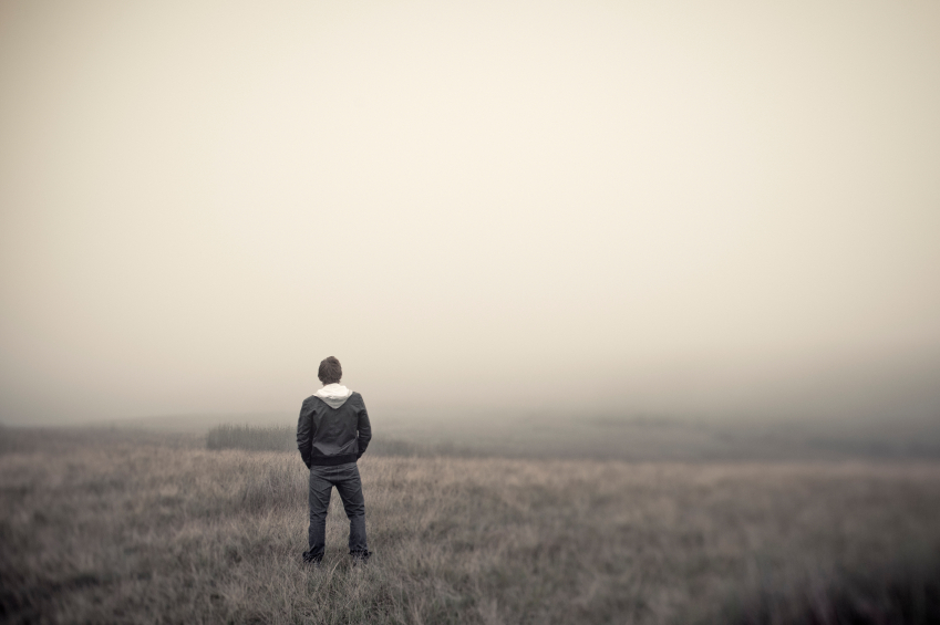 Man standing alone in field