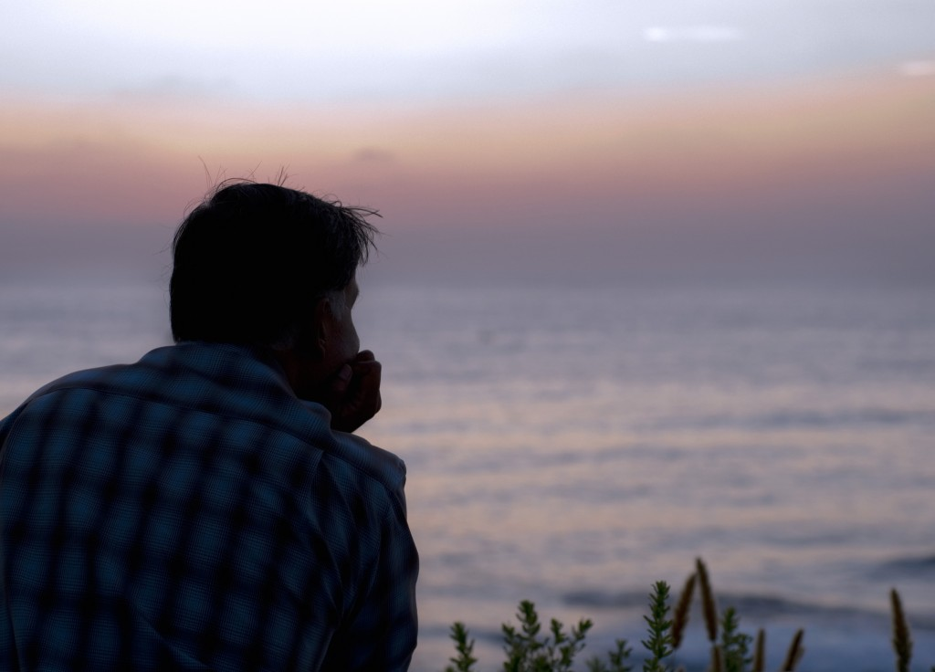 man overlooking ocean