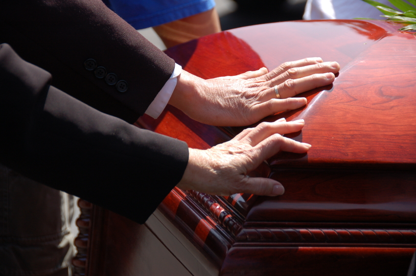 hands on casket