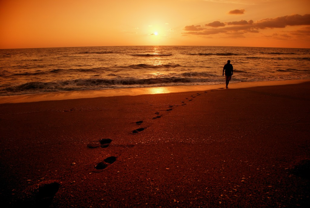 walking on beach at sunset