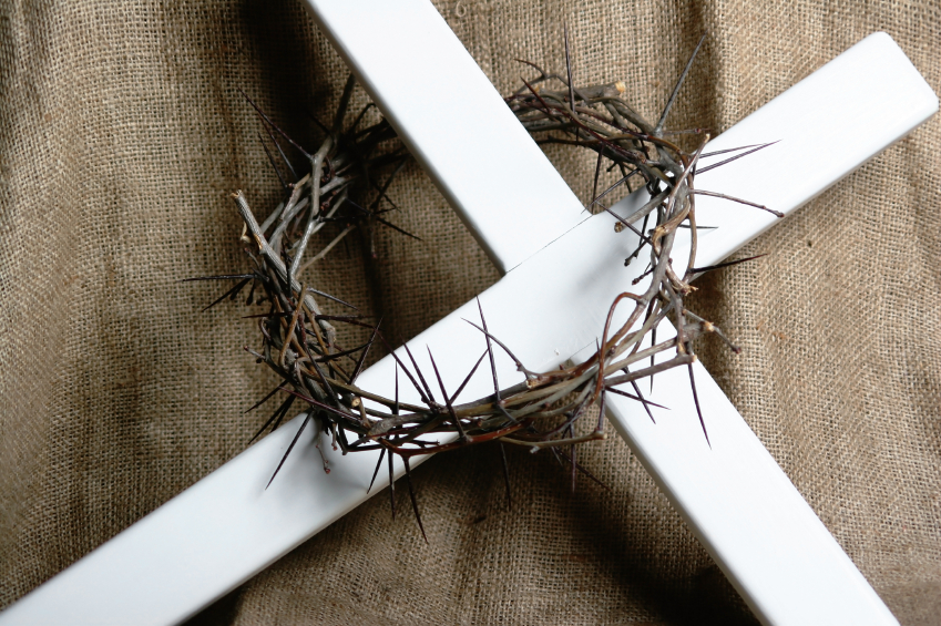 white cross with crown of thorns