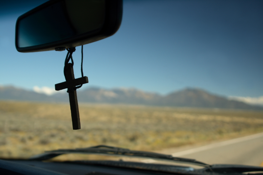 cross hanging in rear view mirror