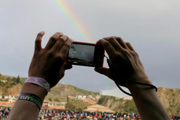 taking picture of rainbow