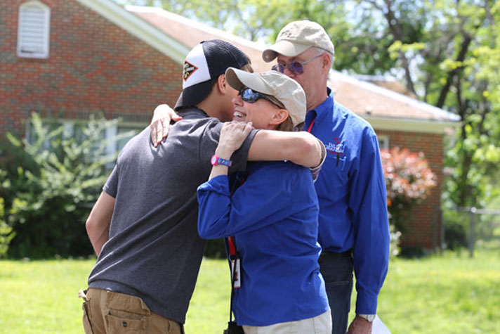 chaplains hugging young man