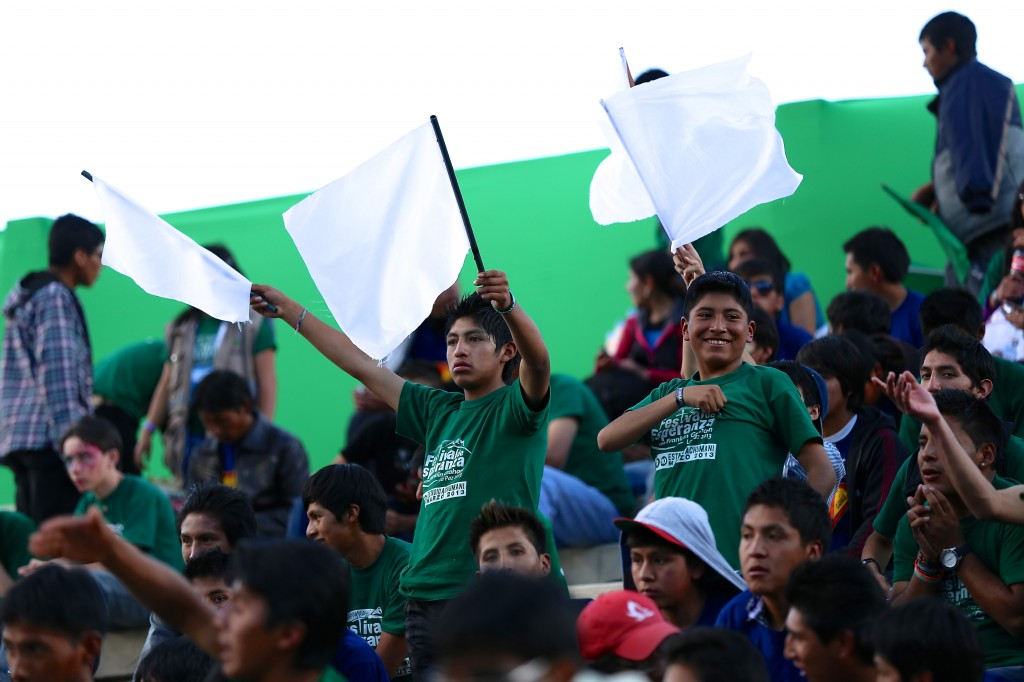 Youth in Bolivia wave flags