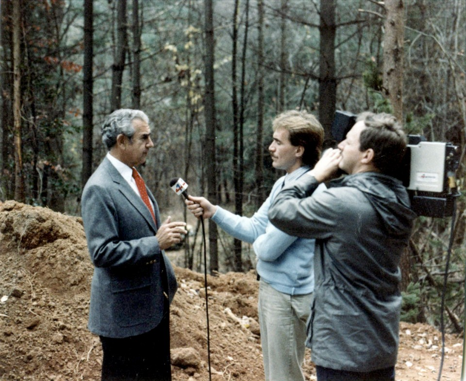Jerry Miller giving a TV interview on the site of The Cove in Asheville, N.C.