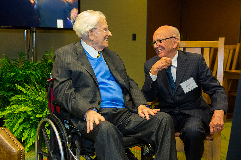Billy Graham catching up with his longtime friend, Rupert Murdoch.
