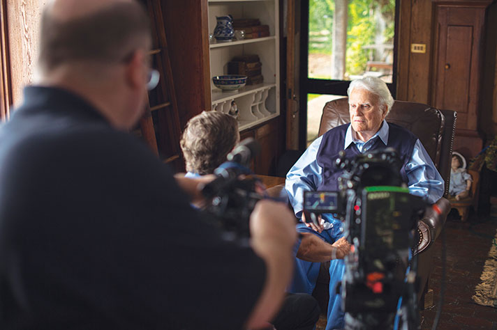 Billy Graham listens to his friend and pastor Don Wilton during taping if the My Hope program The Cross.