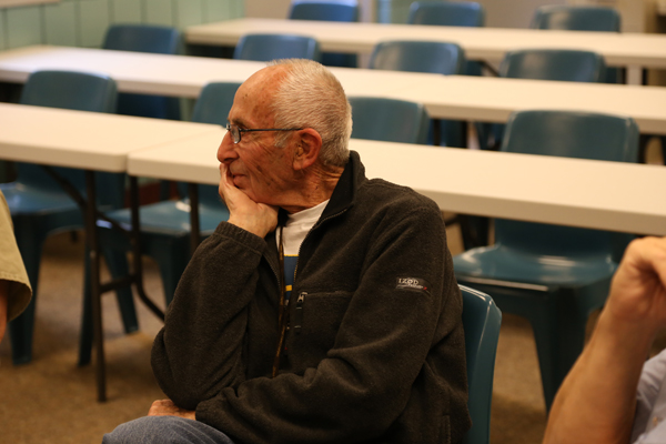 "Chaplain Vern Hildebrandt listens to inmates' testimonies. ""They bless me more than I bless them,"" he said."