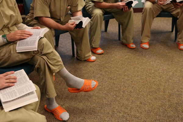 Inmates gather in a circle for Bible study. The jail also holds church services.