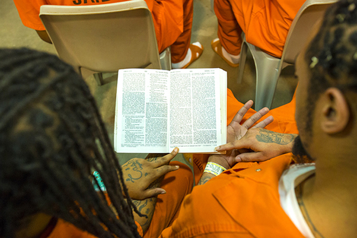Inmates reading Bible