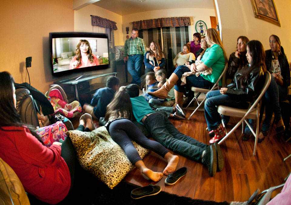 "Felicitas Aranda hosted 50 people at her San Diego, Calif., home to watch ""Momentos Decisivos,"" the Spanish version of the ""Defining Moments"" video."