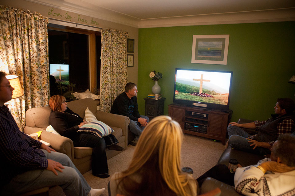 "At a My Hope gathering at a home in Lansing, Mich., six people prayed the prayer of repentance together after watching ""The Cross."""