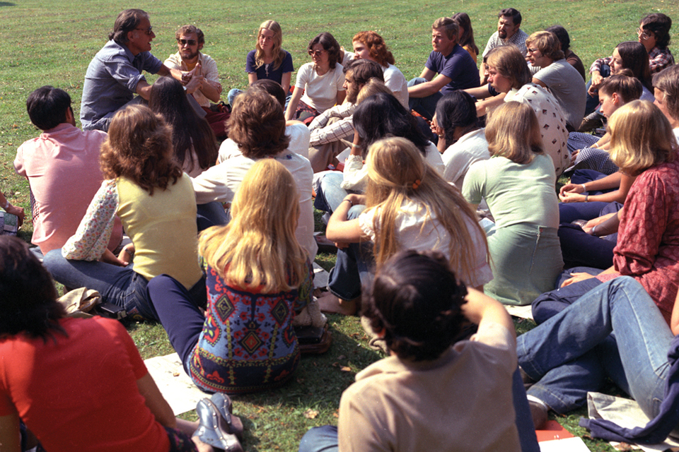 Billy Graham and students on lawn