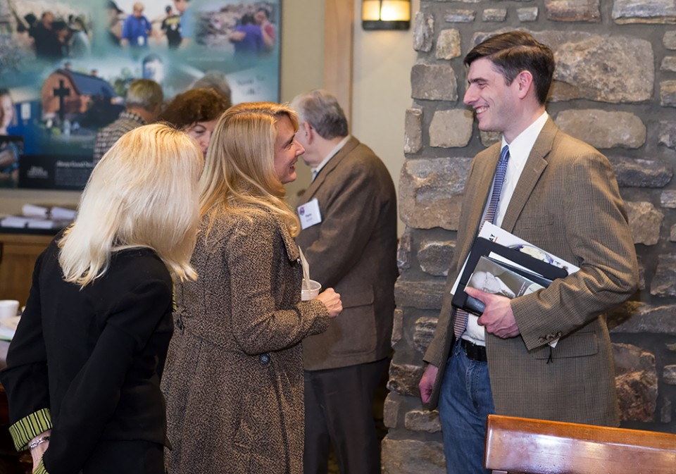 Will Graham talks with members of the NPC and DPLN inside the Billy Graham headquarters.