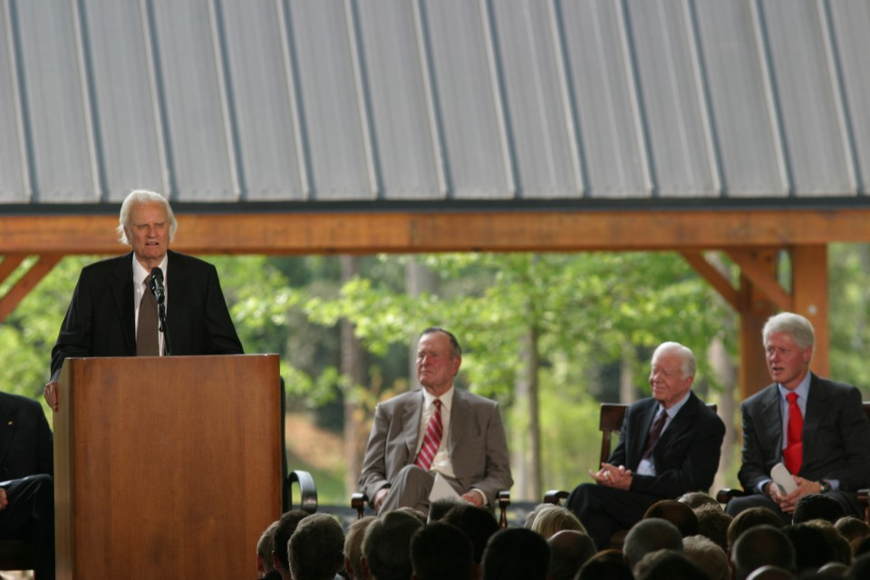 Billy Graham speaks as three presidents look on.