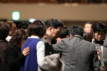 Counselors pray in Fukuoka