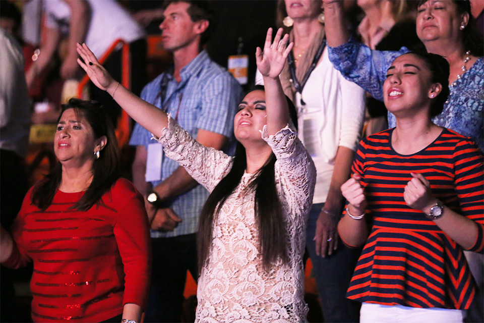 Worshiping the one true God in both English and Spanish on Sunday night at the Don Haskins Center.