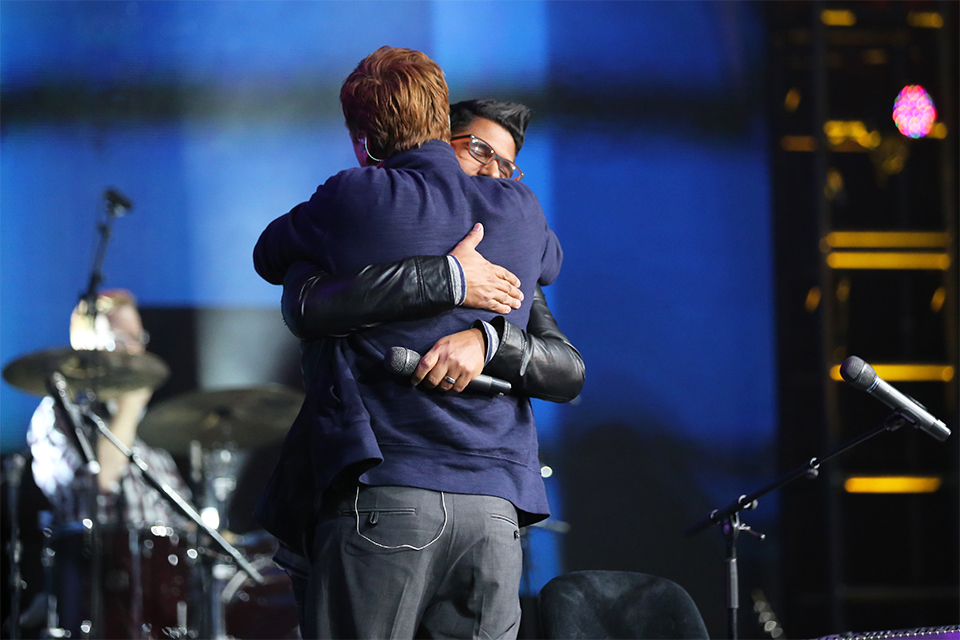 "Michael W. Smith and Daniel Calveti hug at the end of their bilingual version of ""I Surrender All."""