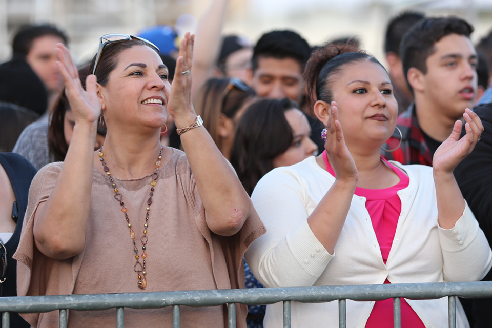 Two women clapping