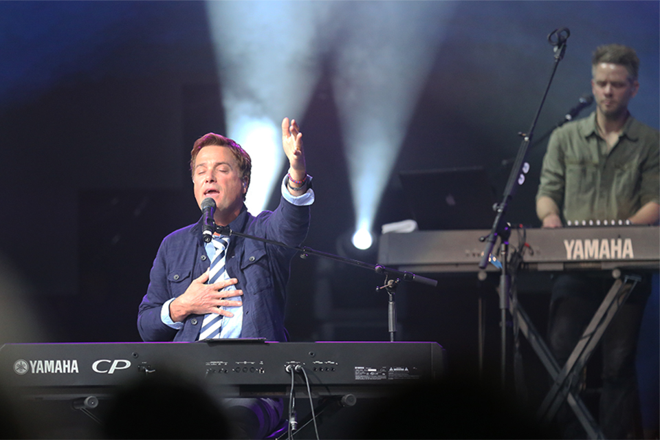 Grammy Award winning artist Michael W. Smith led a packed stadium in worship Sunday night.