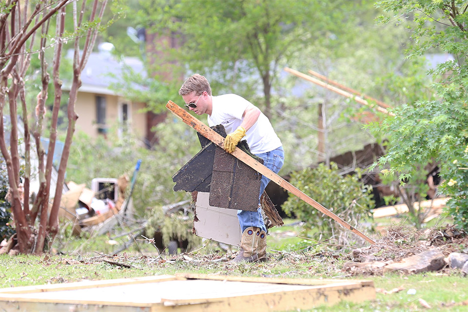 "Just picking up the debris and belongings strewn out in people's yards seemed insurmountable in Winston County, which has suffered great damage and at least nine confirmed deaths. Some residents talked about ""finally starting to regroup."""