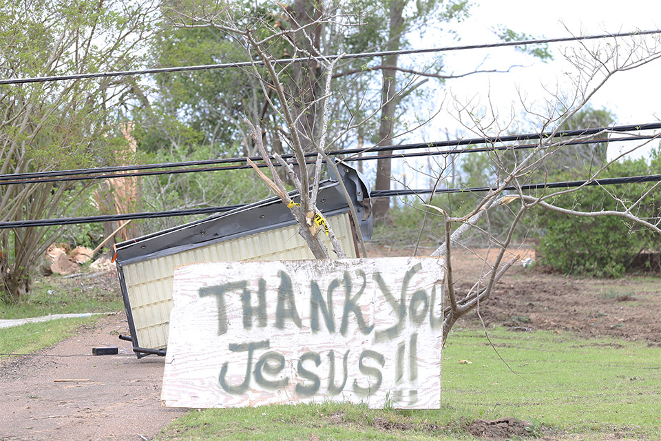 "Some were still in shock, but many Louisville residents were thanking Jesus after Monday's monster mile-wide tornado passed. ""Just praised God that I'm still alive,"" one resident said."