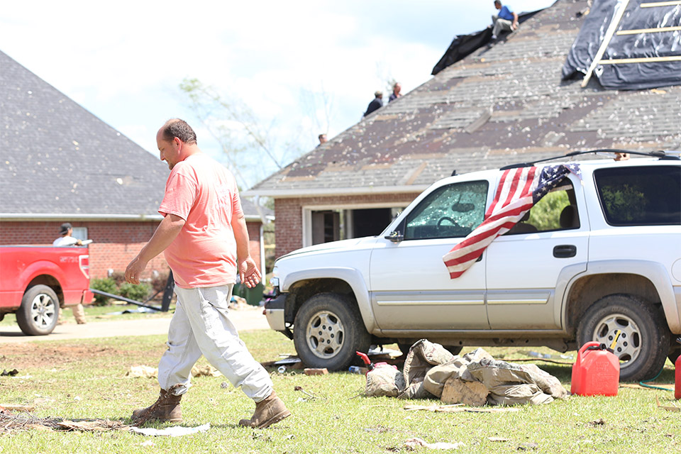 "Stevie Herrington, a 37-year-old forestry teacher, was counting his blessings to be alive, despite his home totaled. ""God is good,"" he said Wednesday. ""I thought I was in bad shape but my neighbors literally have nothing left."""