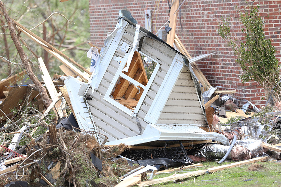 Sections of houses were snapped off, laying in yards and driveways. Police and other first responders circled the neighborhoods and kept guard in some of the dangerous areas, power lines dotting some of the roads.