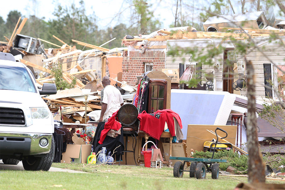 The activity around destroyed houses on Wednesday was brisk, as neighbors and friends from unscathed parts of town came over to lend a hand wherever they could.