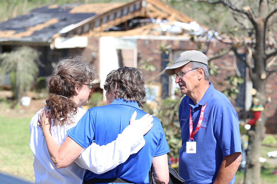Lending a comforting hand and a listening ear, chaplains pray with family members of a homeowner who lost her husband two weeks before losing her home, but is leaning on the Lord's strength.