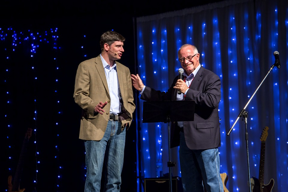 Pastor John Curtis of Broken Hill Church of Christ in Australia talks with Will Graham during the Reality 2014 weekend.