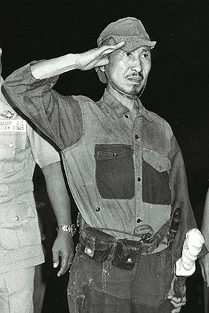 Hiroo Onoda salutes  after surrendering on Lubang Island in the Philippine on March 11, 1974.