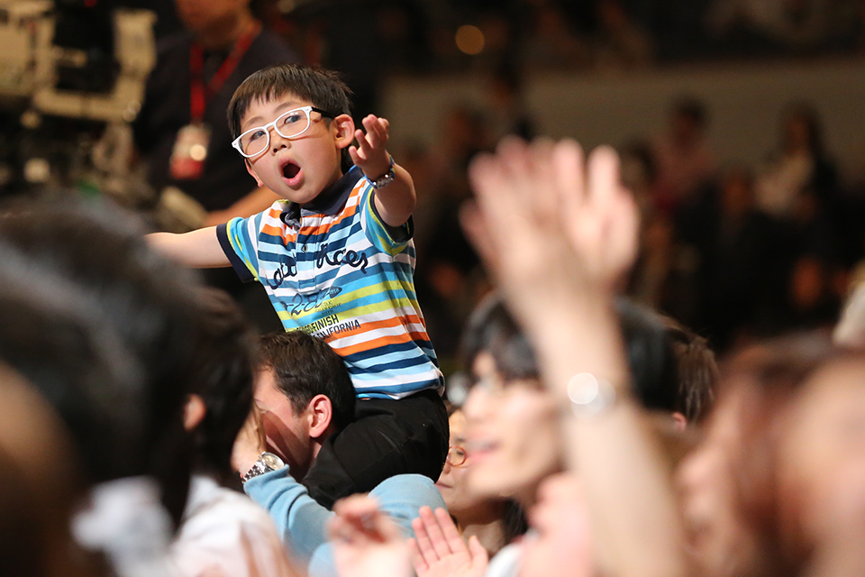 boy in crowd