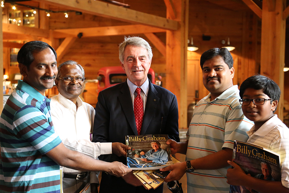Tom Phillips, Vice President of the Billy Graham Library (middle) was pleased to learn that Sunder Rao (to his right) attended a Billy Graham Crusade many years ago in India. Phillips presented Rao with a copy of God's Ambassador.