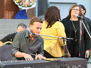 Michael W. Smith and the Tommy Coomes Band performed on a makeshift ground-level stage.