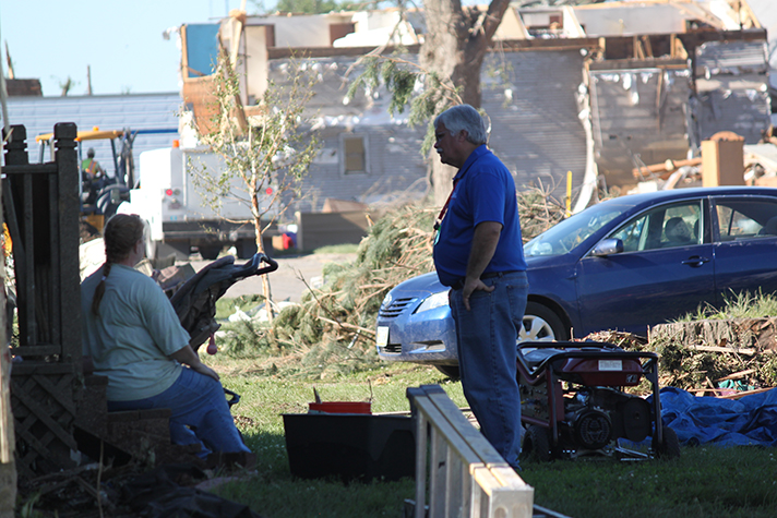 Al New of the Rapid Response Team listens to a resident share her story in Pilger, Nebraska, where twin tornadoes demolished this small town on Monday.