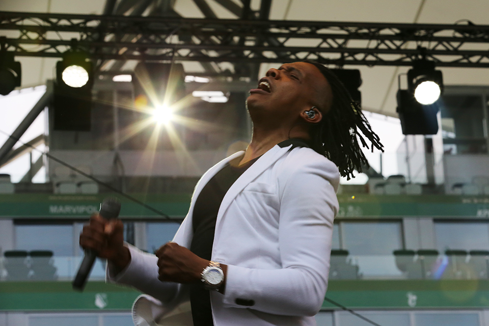 "Michael Tait, lead singer of the Newsboys, was dynamic and energetic as he told the new believers to ""live with abandon."""