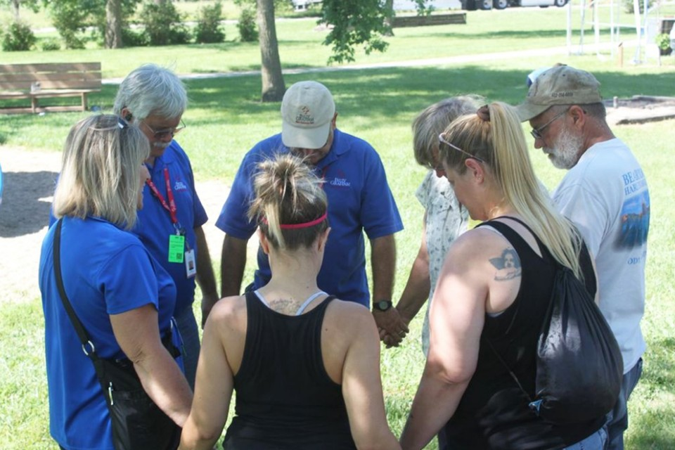 Chaplains and Pilger residents prayed together in a local park.