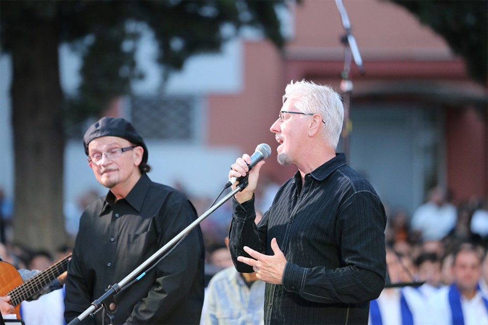 "Tommy Coomes and John Barber sing ""My Hope is in the Lord,"" including a verse sung in the native language."