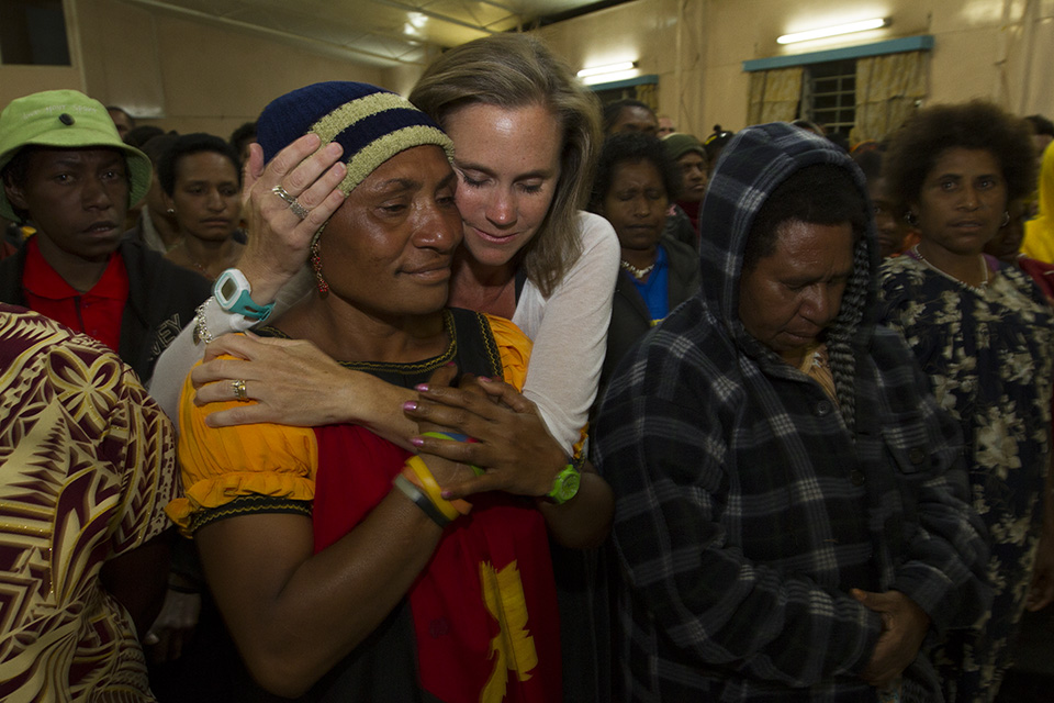 After speaking at the women's meeting attended by 700, Kendra Graham hugged and prayed with several of the women.