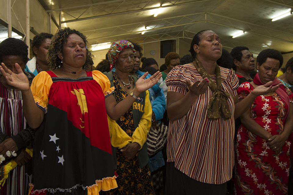 Worshiping God at a women's event that featured music and a Gospel message from Kendra Graham